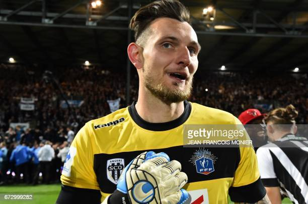Angers' French goalkeeper Alexandre Letellier celebrates after winning the French Cup semifinal match between Angers and EA Guingamp on April 25 2017...