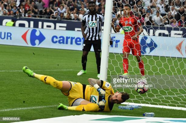 Angers' French goalkeeper Alexandre Letellier dives for the ball during the French Cup final football match between Paris SaintGermain and Angers on...