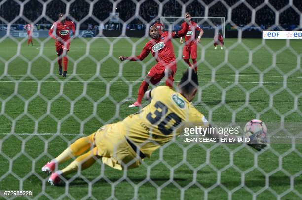 Angers' French goalkeeper Alexandre Letellier stops a penalty during the French Cup semifinal football match between Angers and Guingamp on April 25...