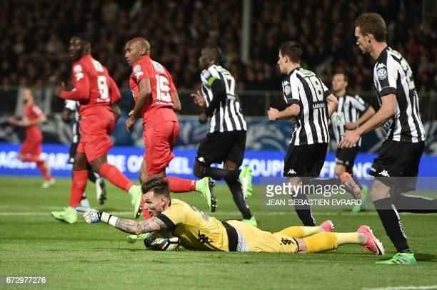 Angers' French goalkeeper Alexandre Letellier stops the ball during the French Cup semifinal match between Angers and EA Guingamp on April 25 2017 at...