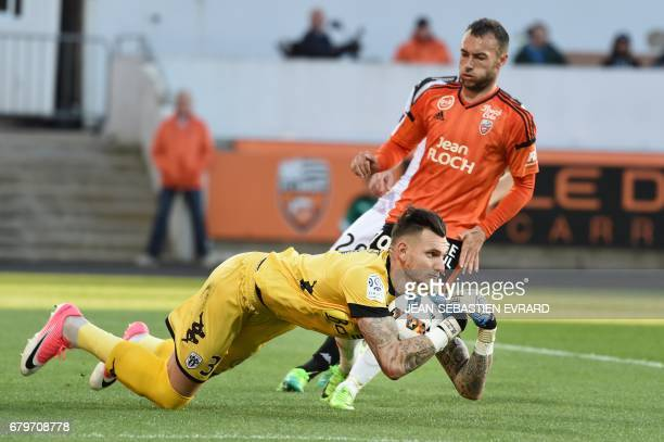 Angers' French goalkeeper Alexandre Letellier stops the ball during the French L1 football match between Lorient and Angers on May 6 2017 at the...