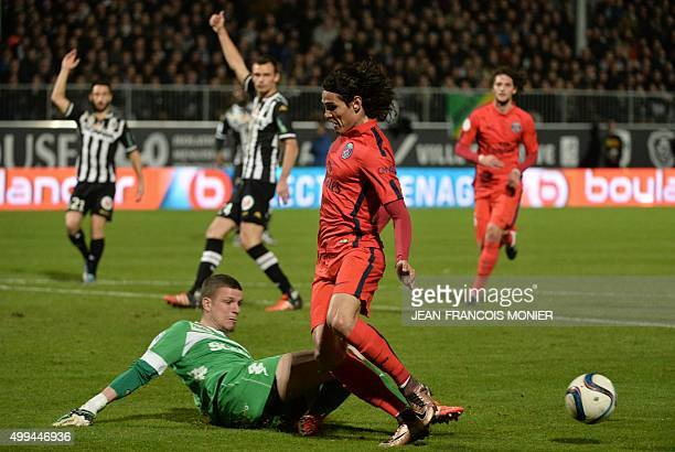 Angers' French goalkeeper Ludovic Butelle vies with Paris SaintGermain's Uruguayan forward Edinson Cavani during the French L1 football match between...