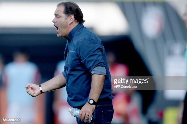 Angers' French head coach Stephane Moulin gestures during the French L1 football match between Angers and Lille at The RaymondKopa Stadium in Angers...