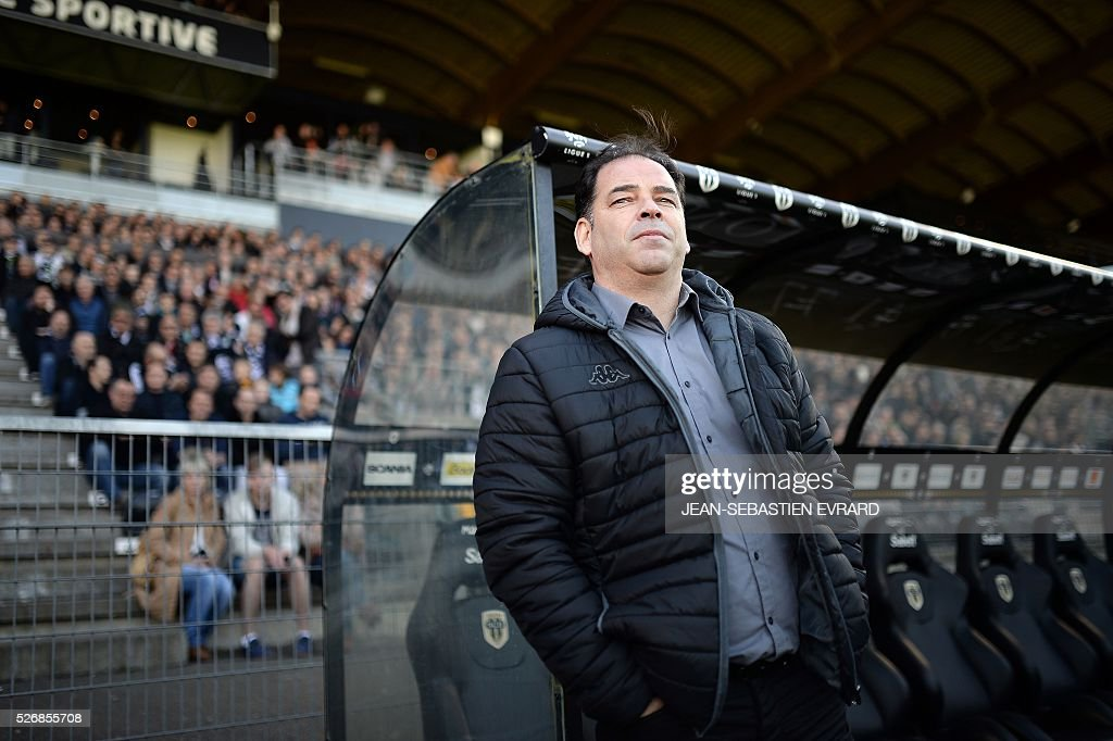 Angers' French head coach Stephane Moulin looks on during the French L1 football match between Angers and Marseille on May 1, 2016 at the Jean Bouin stadium in Angers, western France.