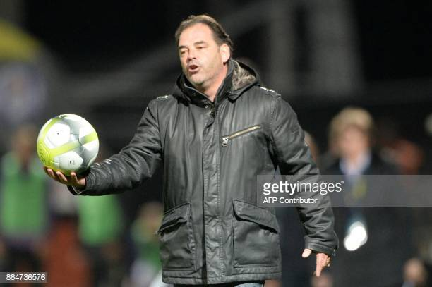 Angers' French head coach Stephane Moulin takes the ball during the French L1 Football match between Angers and Toulouse on October 21 in RaymondKopa...