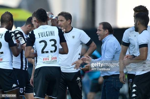 Angers' French head coach Stephane Moulin talks to his players during the French L1 football match between Angers and Bordeaux at RaymondKopa Stadium...