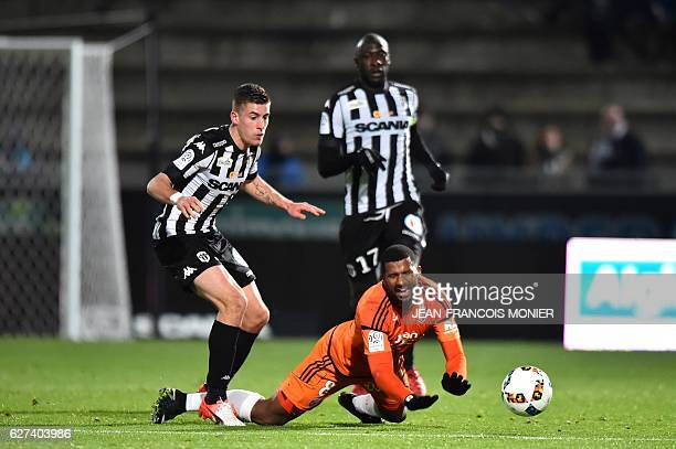 Angers' French midfielder Baptiste Santamaria vies with Lorient's Portuguese midfielder Carlos Miguel Cafu during the French L1 football match...