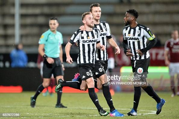 Angers' French midfielder Flavien Tait is congratulated by teammates after scoring a goal during the French L1 football match between Angers and Metz...