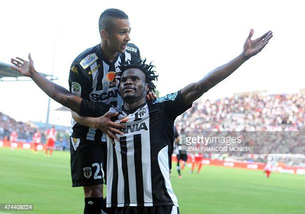 Angers' French midfielder Guy Adolphe Ngosso is congratulated by Angers' French midfielder Axel Ngando after scoring a goal during the French L2...