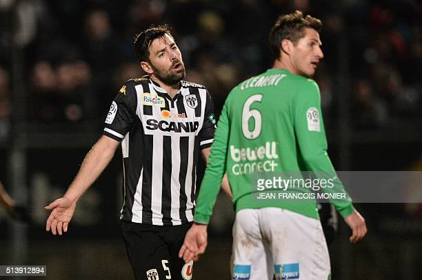 Angers' French midfielder Thomas Mangani and SaintEtienne's French midfielder Jeremy Clement react during the French L1 football match between Angers...