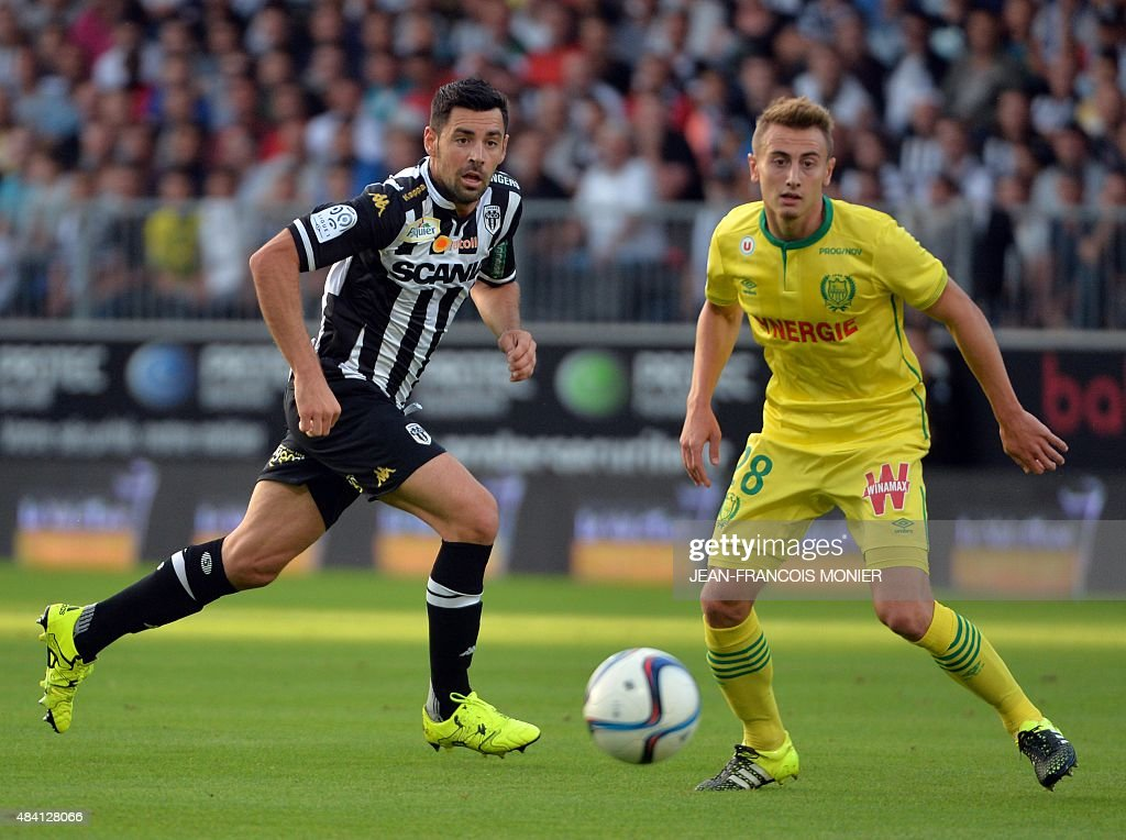 Angers' French midfielder Thomas Mangani vies for the ball with Nantes' French midfielder Valentin Rongier during the French L1 football match...