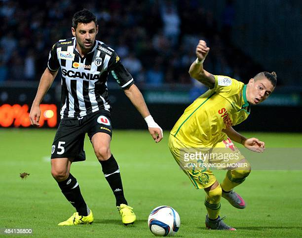 Angers' French midfielder Thomas Mangani vies for the ball with Nantes' Brazilian midfielder Adryan Oliveira Tavares during the French L1 football...