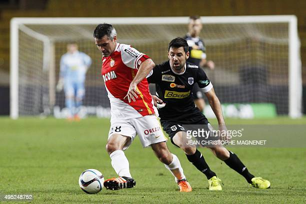 Angers' French midfielder Thomas Mangani vies with Monaco's French midfielder Jeremy Toulalan during the French L1 football match between Monaco and...