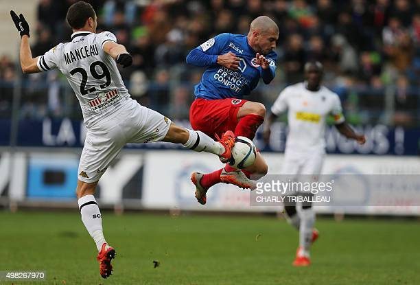 Angers' French midfielder Vincent Manceau vies for the ball with Caen's French midfielder Vincent Bessat during the French L1 football match between...