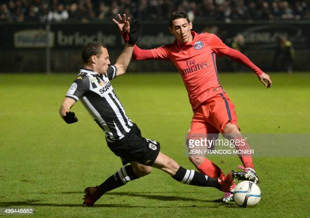 Angers' French midfielder Vincent Manceau vies with Paris SaintGermain's Argentinian forward Angel Di Maria during the French L1 football match...