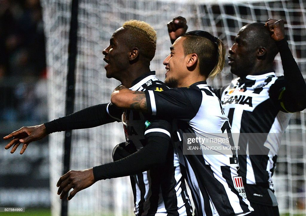 Angers' Guinean forward Mohamed Yattara celebrates with his teammates Angers' French forward Billy Ketkeophomphone and Angers' Guinean defender...