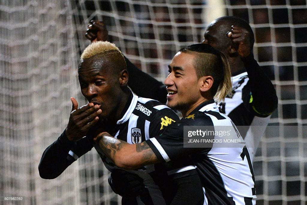 Angers' Guinean forward Mohamed Yattara celebrates with teammates after scoring during the French L1 football match between Angers and Monaco at Jean...