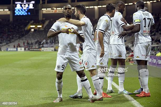 Angers' Guinean midfielder Abdoul Camara celebrates with his teammates after scoring during the French L1 football match Toulouse vs Angers on...