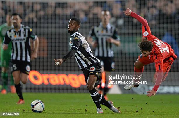 Angers' Guinean midfielder Abdoul Camara vies with Paris SaintGermain's Brazilian defender Maxwell during the French L1 football match between Angers...
