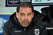 Angers' head coach Stephane Moulin is pictured before the start of the French Cup quarter final football match between Moulins and Angers on March 25...