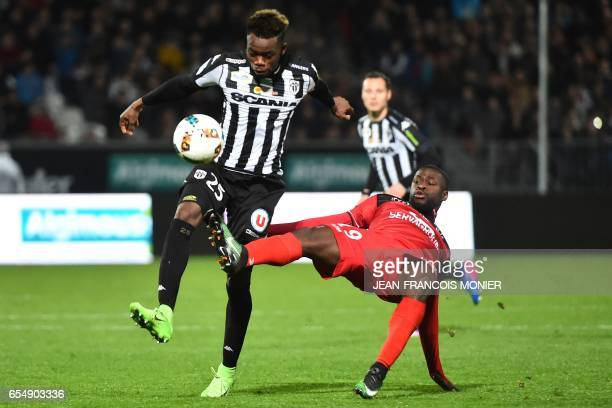 Angers' Ivorian defender Abdoulaye Bamba vies with Guingamp's French midfielder Yannis Salibur during the French L1 football match between Angers and...