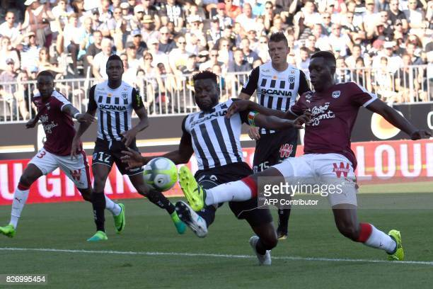 Angers' Ivorian defender Ismael Traore vies for the ball with Bordeaux's French forward Alexandre Mendy during the French L1 football match between...