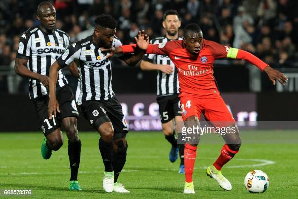 Angers' Ivorian defender Ismael Traore vies with Paris SaintGermain's French midfielder Blaise Matuidi during the French L1 football match between...