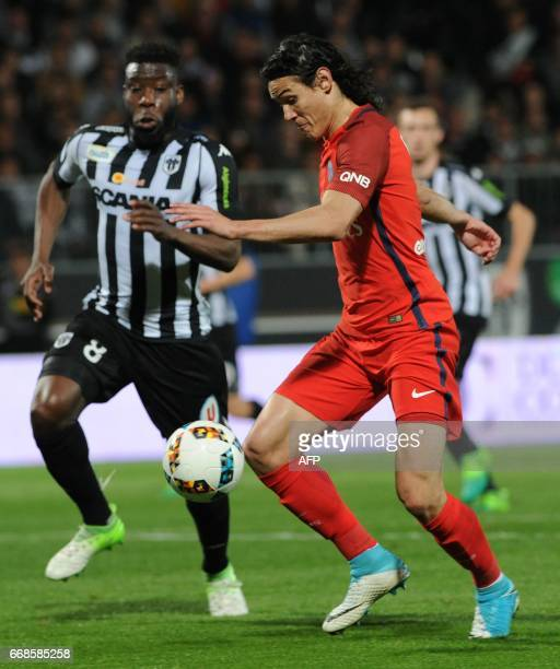 Angers' Ivorian defender Ismael Traore vies with Paris SaintGermain's Uruguayan forward Edinson Cavani during the French L1 football match between...