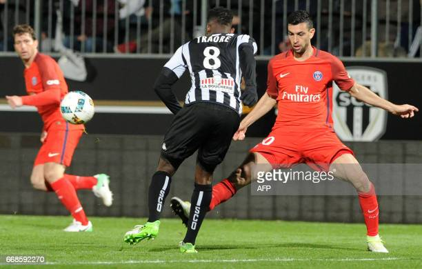 Angers' Ivorian defender Ismael Traore vies with Paris SaintGermain's Argentinian forward Javier Pastore during the French L1 football match between...