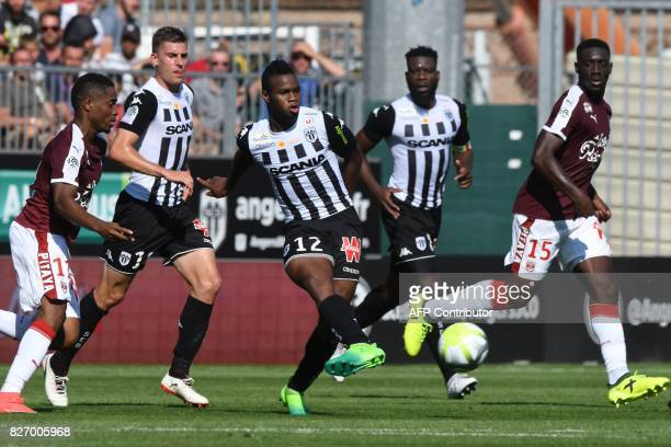 Angers' Malian midfielder Lassana Coulibaly vies for the ball with Bordeaux's Guinean forward Francois Kamano and Bordeaux's French forward Alexandre...