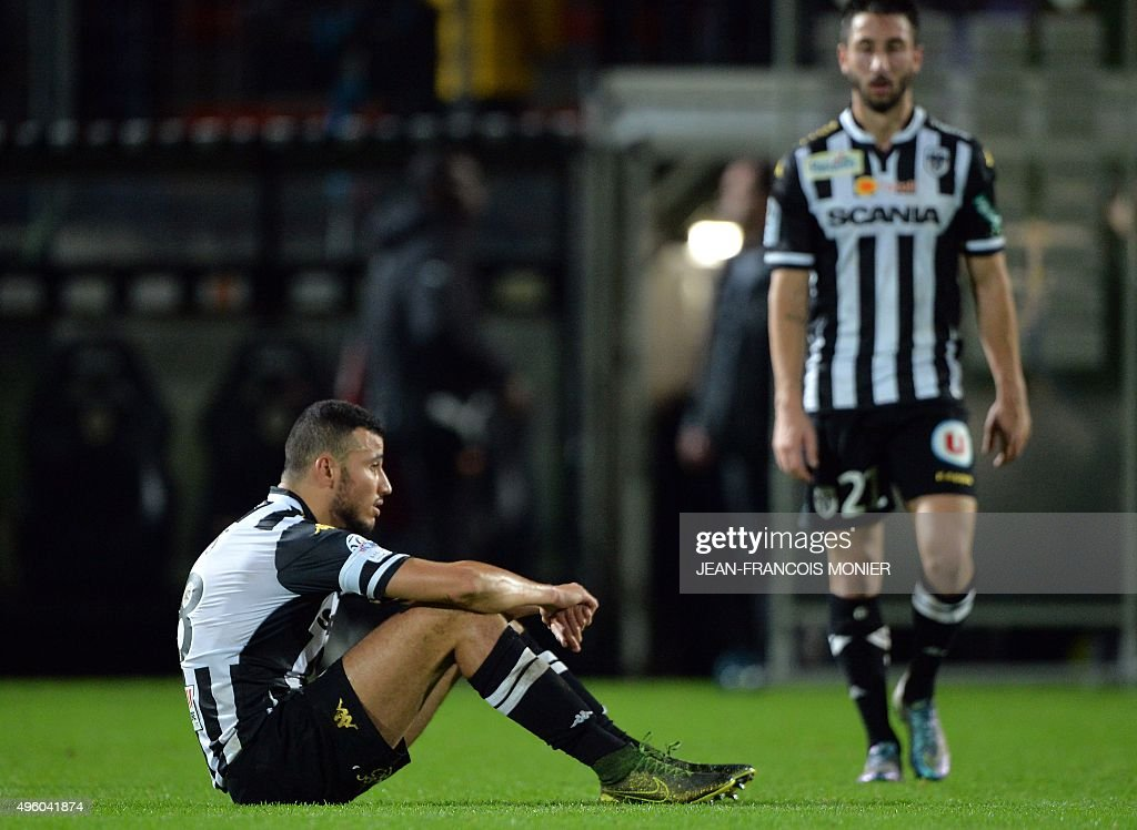 Angers' Moroccan midfielder Romain Saiss and Angers' French defender Yoann Andreu react after during the French L1 football match between Angers and...