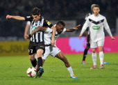Angers' Olivier Auriac vies with Moulins' Olivier Kamata during a French Cup quarter final football match between Moulins and Angers on March 25 2014...