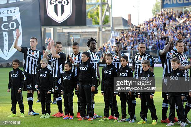 Angers' players applaud before the start of French L2 football match between Angers and NimesOlympique on May 22 2015 in Jean Bouin Stadium in Angers...