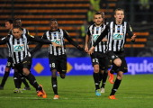 Angers' players celebrate after winning thier French Cup quarter final football match between Moulins and Angers on March 25 2014 at the Jean Laville...