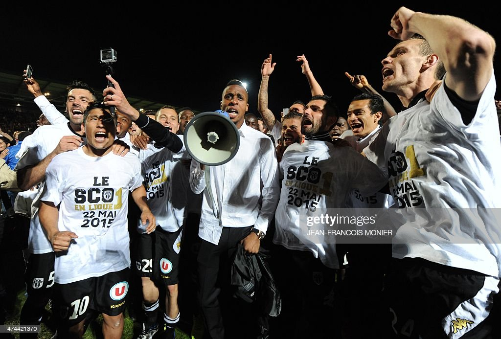 Angers' players celebrate with their supporters after they won the French L2 football match between Angers and NimesOlympique on May 22 2015 in Jean...