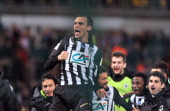 Angers' Romain Thomas and team mates celebrate after winning their French Cup quarter final football match between Moulins and Angers on March 25...