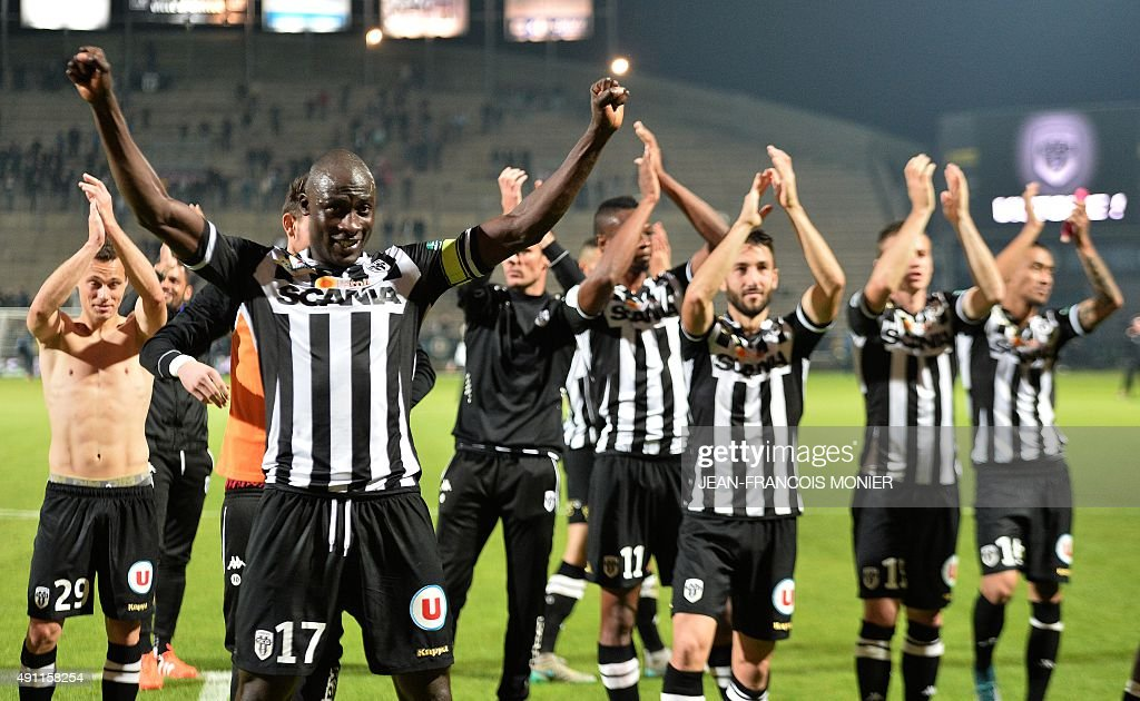 Angers' Senegalese midfielder Cheikh N'Doye and teammates celebrate at the end of the French L1 football match between Angers and Bastia on October 3...