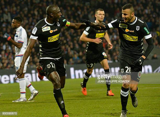 Angers' Senegalese midfielder Cheikh N'Doye celebrates after scoring a goal during the French L1 football match Lyon vs Angers on December 5 at the...