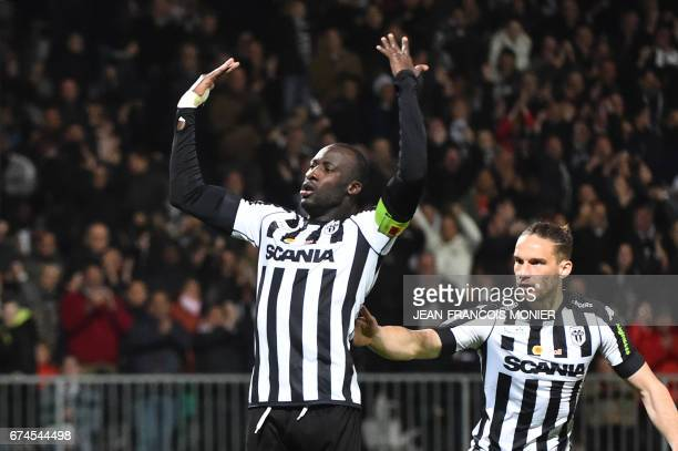 Angers' Senegalese midfielder Cheikh N'Doye celebrates after scoring during the French L1 football match between Angers and Lyon at RaymondKopa...