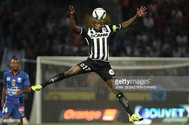 Angers' Senegalese midfielder Cheikh N'Doye heads the ball during the French L1 football match between Angers and Nice on August 29 2015 at the Jean...