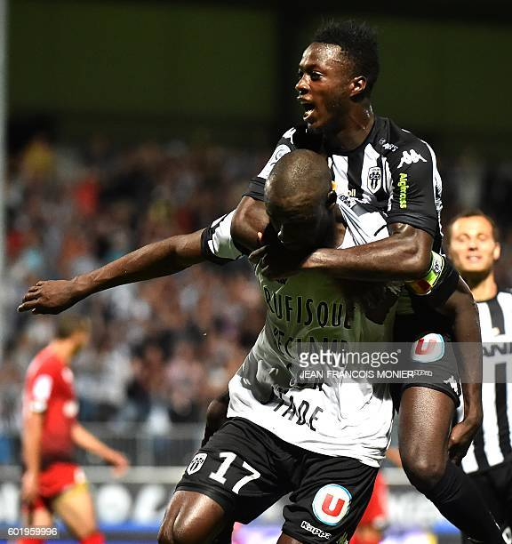 Angers' Senegalese midfielder Cheikh N'Doye is congratulated by Angers' French forward Nicolas Pepe after scoring a goal during the French L1...