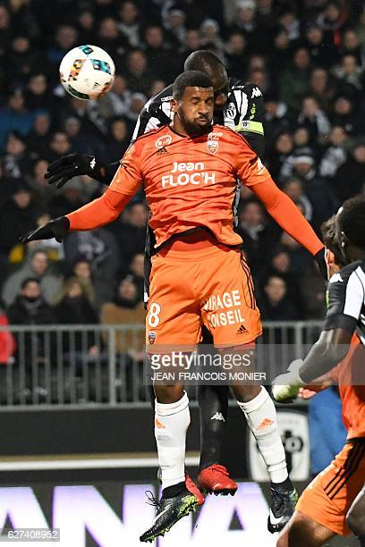 Angers' Senegalese midfielder Cheikh N'Doye scores a header over Lorient's Portuguese midfielder Carlos Miguel Cafu during the French L1 football...
