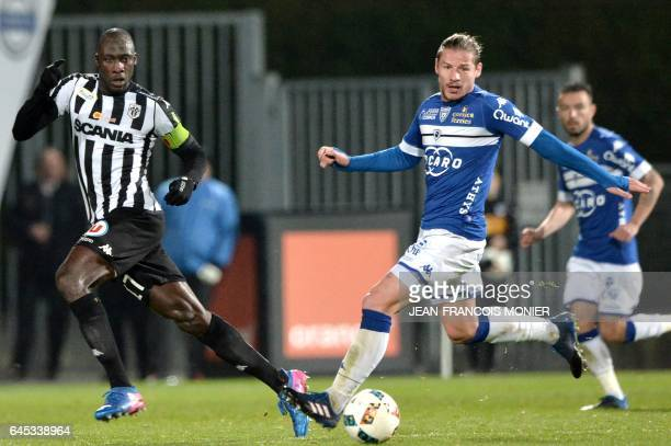 Angers' Senegalese midfielder Cheikh N'Doye vies with Bastia's Algerian midfielder Mehdi Mostefa during the French L1 football match between Angers...