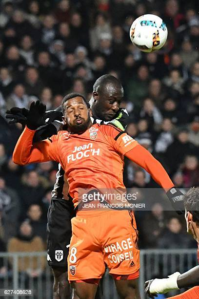 Angers' Senegalese midfielder Cheikh N'Doye vies with Lorient's Portuguese midfielder Carlos Miguel Cafu during the French L1 football match between...