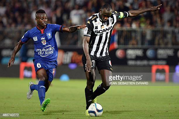 Angers' Senegalese midfielder Cheikh N'Doye vies with Nice's Ivorian midfielder Jean Michel Seri during the French L1 football match between Angers...