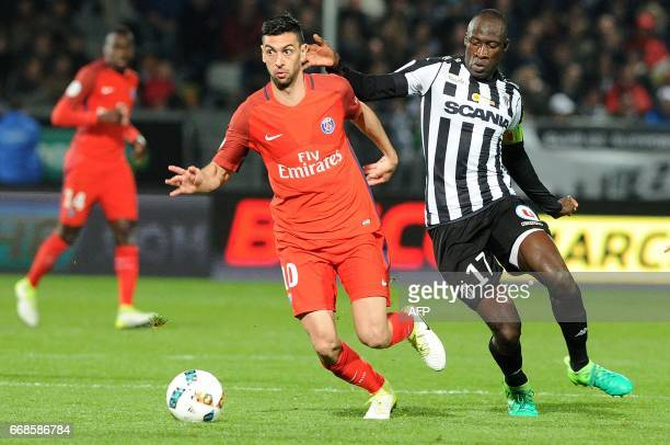 Angers' Senegalese midfielder Cheikh N'Doye vies with Paris SaintGermain's Argentinian forward Javier Pastore during the French L1 football match...