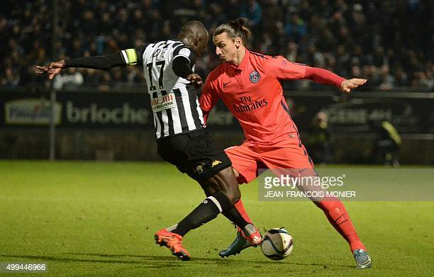 Angers' Senegalese midfielder Cheikh N'Doye vies with Paris SaintGermain's Swedish forward Zlatan Ibrahimovic during the French L1 football match...