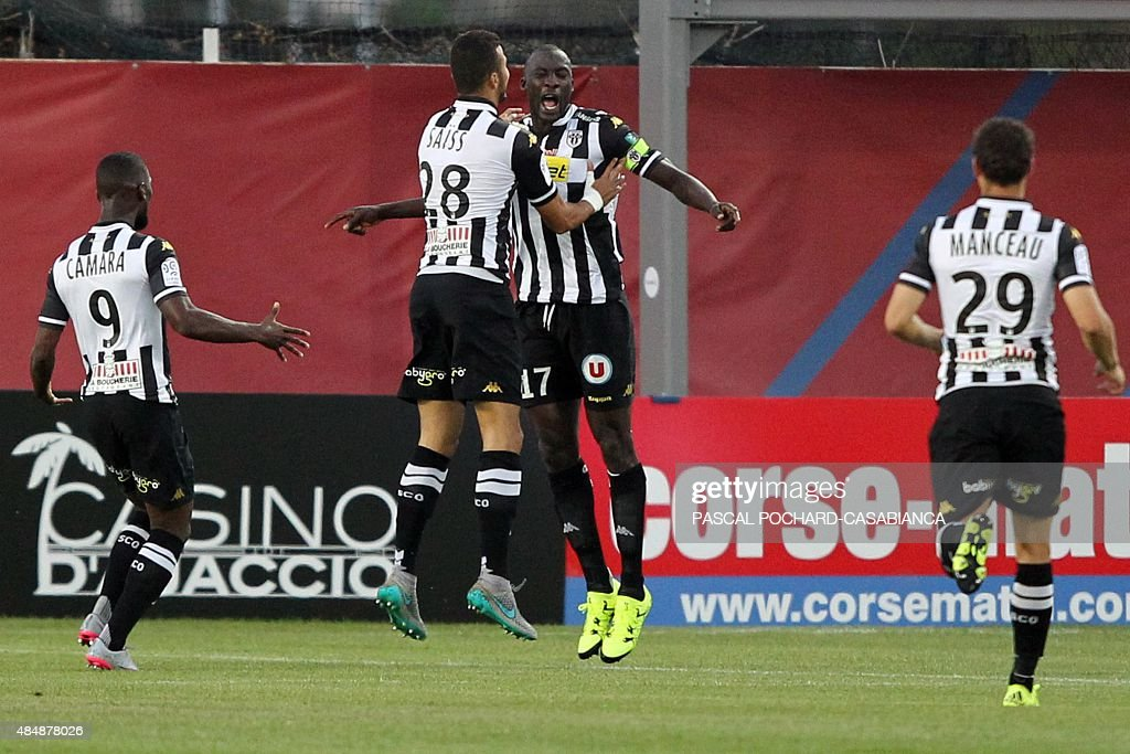 Angers' Senegalese midfielder Cheikh N'Doyes is congratulated by teammates after scoring a goal during the French L1 football match GFC Ajaccio...