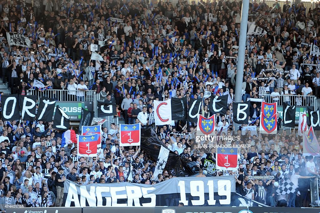 Angers' supporters cheer during the French L2 football match between Angers and NimesOlympique on May 22 2015 in Jean Bouin Stadium in Angers western...