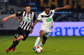 Angers' Yohan Eudeline vies with Moulins' Pedro Kamata during the French Cup quarter final football match between Moulins and Angers on March 25 2014...